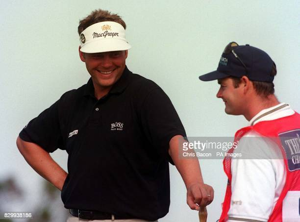 Ireland's Darren Clarke shares a joke with his caddie during the 2nd day of the 126th Open Championship at Royal Troon this morning Clarke finished 9...