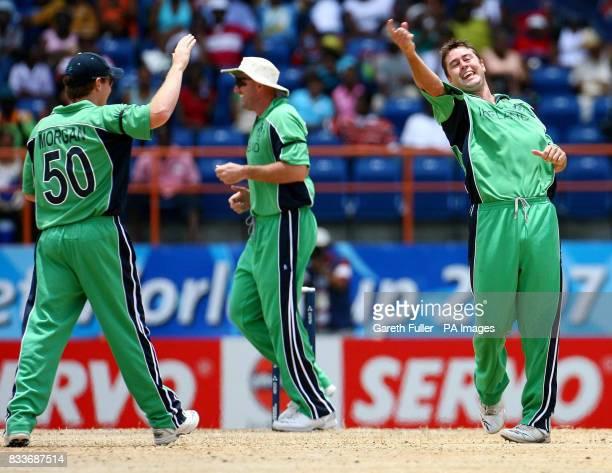 Ireland's David LangfordSmith celebrates taking the wicket of Sri Lanka's Kumar Sangakkara with Eoin Morgan and Jeremy Bray during the ICC Cricket...