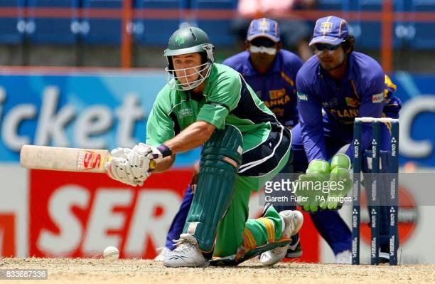 Ireland's David LangfordSmith in action as Sri Lanka's wicketkeeper Kumar Sangakkara watches on during the ICC Cricket World Cup Super Eights match...