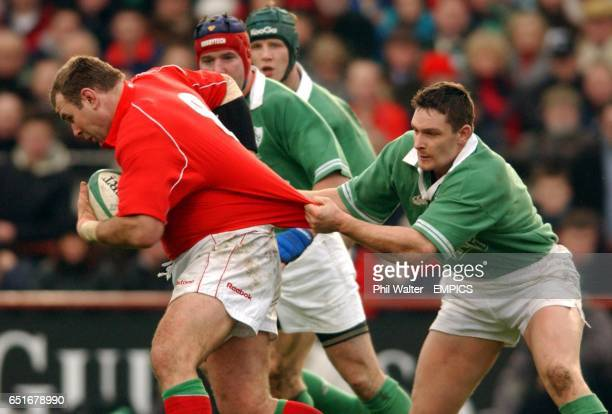 Ireland's David Wallace pulls the shirt of Wales' Scott Quinnell