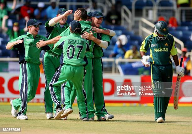 Ireland's Davis LangfordSmith celebrates after taking the wicket of Pakistan's Mohammed Hafeez during the ICC Cricket World Cup 2007 Group C match at...