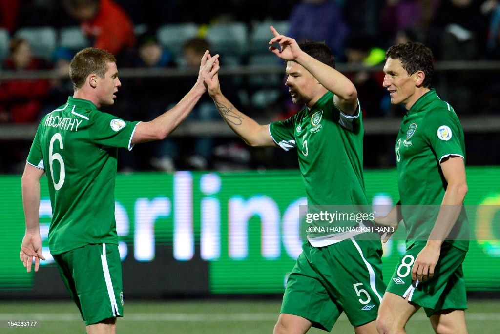 Ireland's defender Darren O'Dea (C) celebrates with teammates after scoring during the FIFA 2014 World Cup group C qualifying football match Faroe Islands vs Ireland at the Torsvollur stadium in Torshavn on October 16, 2012.