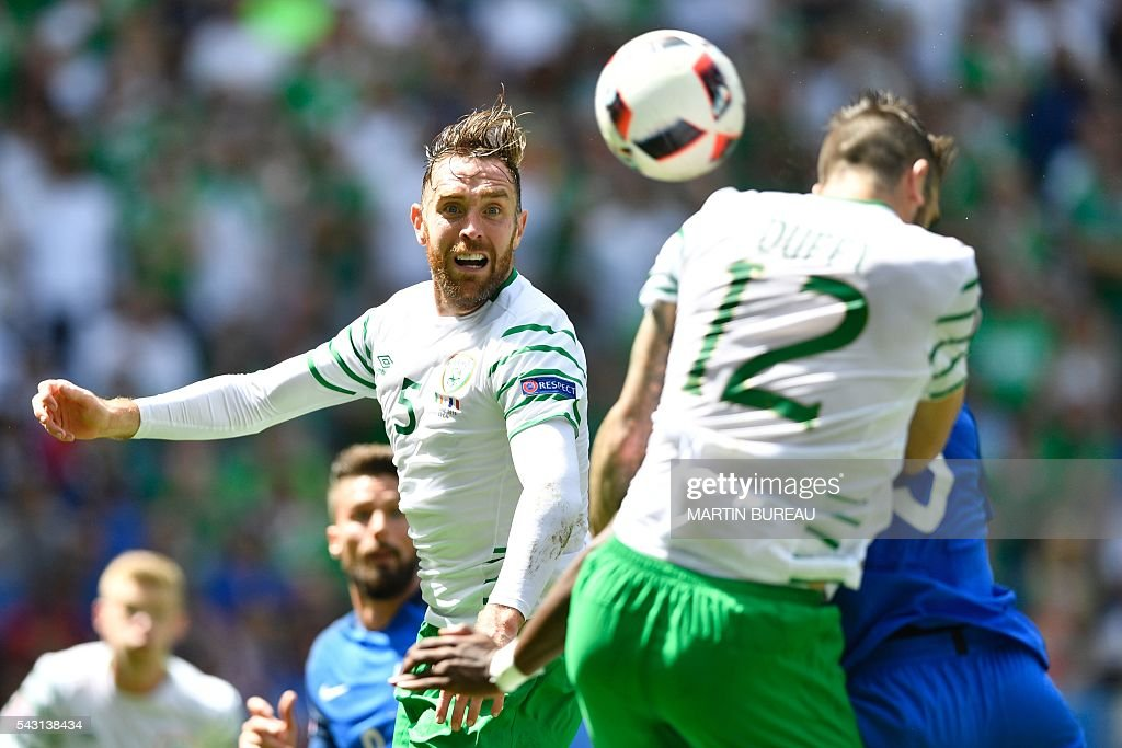 Ireland's defender Richard Keogh (L) heads the ball during the Euro 2016 round of 16 football match between France and Republic of Ireland at the Parc Olympique Lyonnais stadium in Décines-Charpieu, near Lyon, on June 26, 2016. / AFP / MARTIN