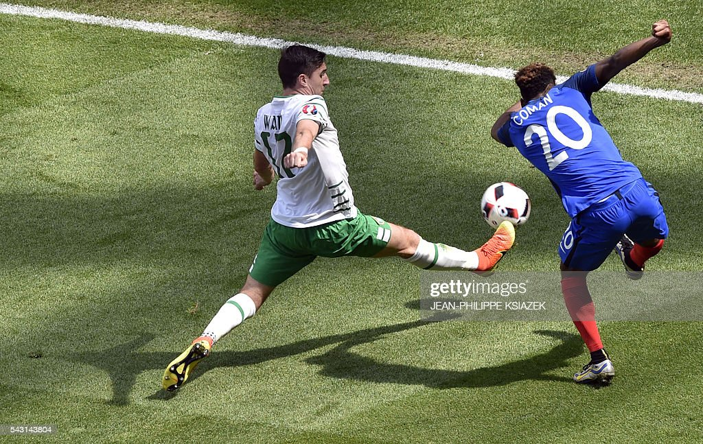 Ireland's defender Stephen Ward and France's forward Kingsley Coman vie for the ball during the Euro 2016 round of 16 football match between France and Republic of Ireland at the Parc Olympique Lyonnais stadium in Décines-Charpieu, near Lyon, on June 26, 2016. / AFP / JEAN