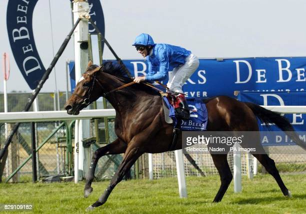Ireland's Doyen ridden by Frankie Dettori wins The King George VI And Queen Elizabeth Diamond Stakes at Ascot Races