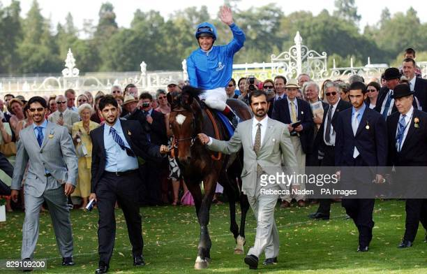 Ireland's Doyen ridden by jockey Frankie Dettori is led into the winners enclosure by trainer Saeed bin Suroor after winning The King George VI And...