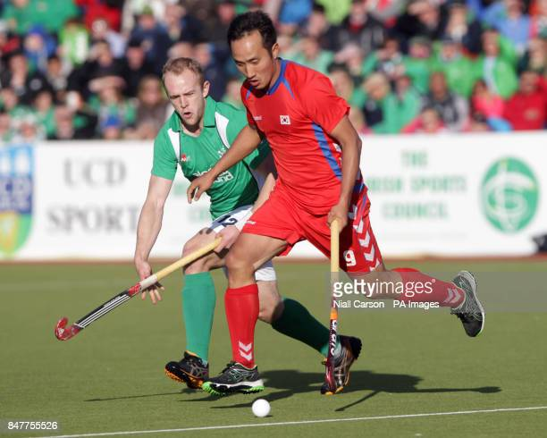 Ireland's Eugene Magee and South Korea's Sung Hoon Yoon during their International Hockey Federation Olympic qualifing match at Belfield in Dublin