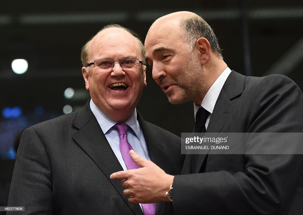 Ireland's Finance Minister <a gi-track='captionPersonalityLinkClicked' href=/galleries/search?phrase=Michael+Noonan&family=editorial&specificpeople=7554249 ng-click='$event.stopPropagation()'>Michael Noonan</a> (L) speaks with European Commissioner for Economic and Financial Affairs, Taxation and Customs Pierre Moscovici at the start of an Eurogroup Finance Ministers meeting at the European Council in Brussels, on January 26, 2015.