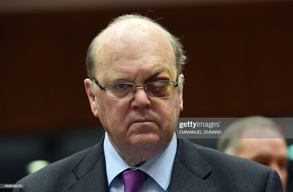 Ireland's Finance Minister <a gi-track='captionPersonalityLinkClicked' href=/galleries/search?phrase=Michael+Noonan&family=editorial&specificpeople=7554249 ng-click='$event.stopPropagation()'>Michael Noonan</a>, who underwent treatment for an eye condition arrives to take part in a European economic and financial affairs (ECOFIN) meeting at the European Council in Brussels, on February 17, 2015. AFP PHOTO/Emmanuel Dunand
