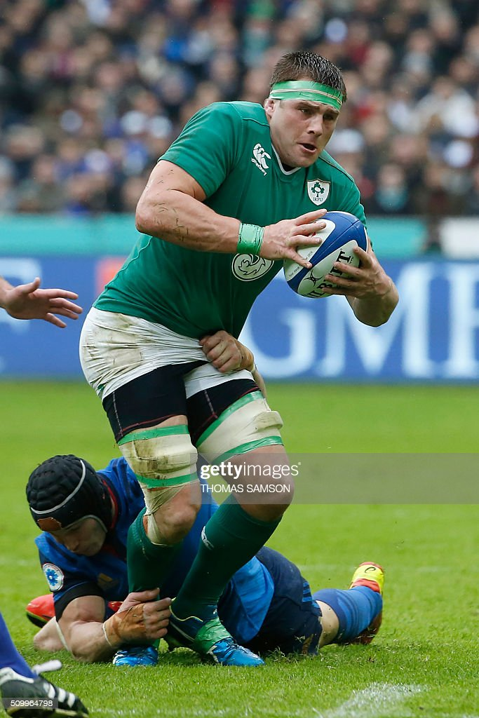 Ireland's flanker CJ Stander (R) is tackled by France's flanker Wenceslas Lauret during the Six Nations international rugby union match between France and Ireland at the Stade de France Stadium in Saint-Denis, north of Paris, on February 13, 2016. AFP PHOTO / THOMAS SAMSON / AFP / THOMAS SAMSON