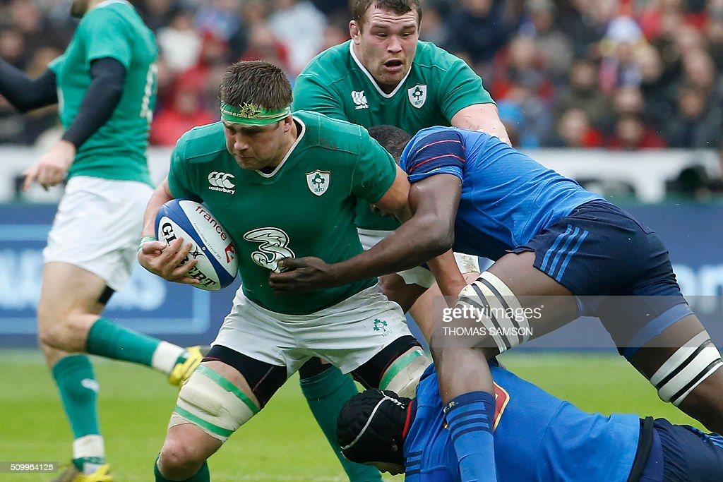 Ireland's flanker CJ Stander (L) is tackled during the Six Nations international rugby union match between France and Ireland at the Stade de France Stadium in Saint-Denis, north of Paris, on February 13, 2016. AFP PHOTO / THOMAS SAMSON / AFP / THOMAS SAMSON