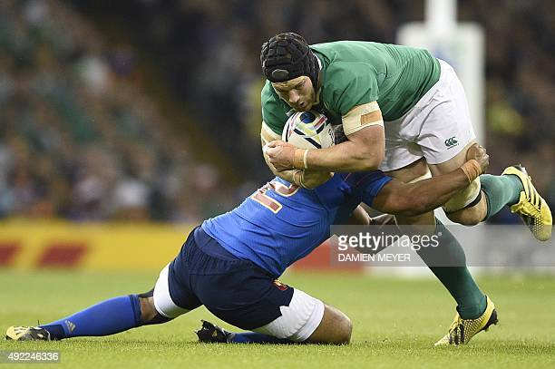 Ireland's flanker Sean O'Brien is tackled by France's hooker Guilhem Guirado during the Pool D match of the 2015 Rugby World Cup between France and...