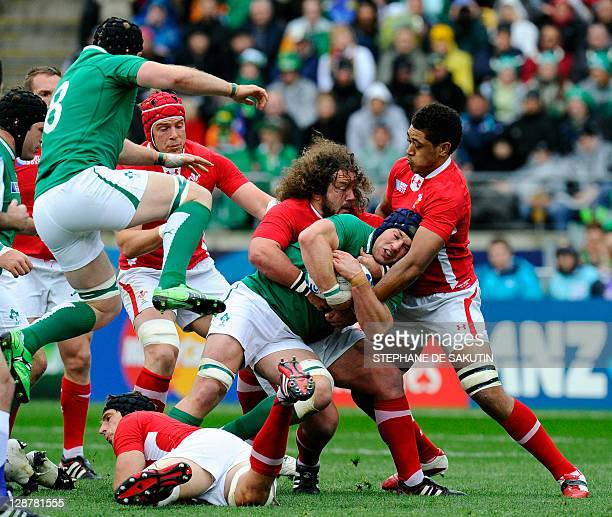 Ireland's flanker Sean O'Brien is tackled by Wales' prop Adam Jones and No8 Toby Faletau during the 2011 Rugby World Cup quarterfinal match Ireland...