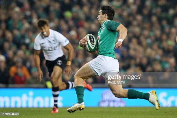 Ireland's flyhalf Joey Carbery makes a break during the international rugby union test match between Ireland and Fiji at Aviva stadium in Dublin on...