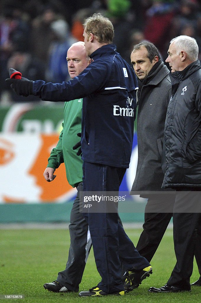 Ireland's football team's head Declan Kidney (L) and France's football team head coach Philippe Saint-Andre (2ndR) talk with the deputy referee Wayne Barnes (2ndL) prior to the Six Nations rugby union match France versus Ireland at the Stade de France in Saint-Denis, outside Paris, on February 11, 2012. The match was cancelled due to the cold.