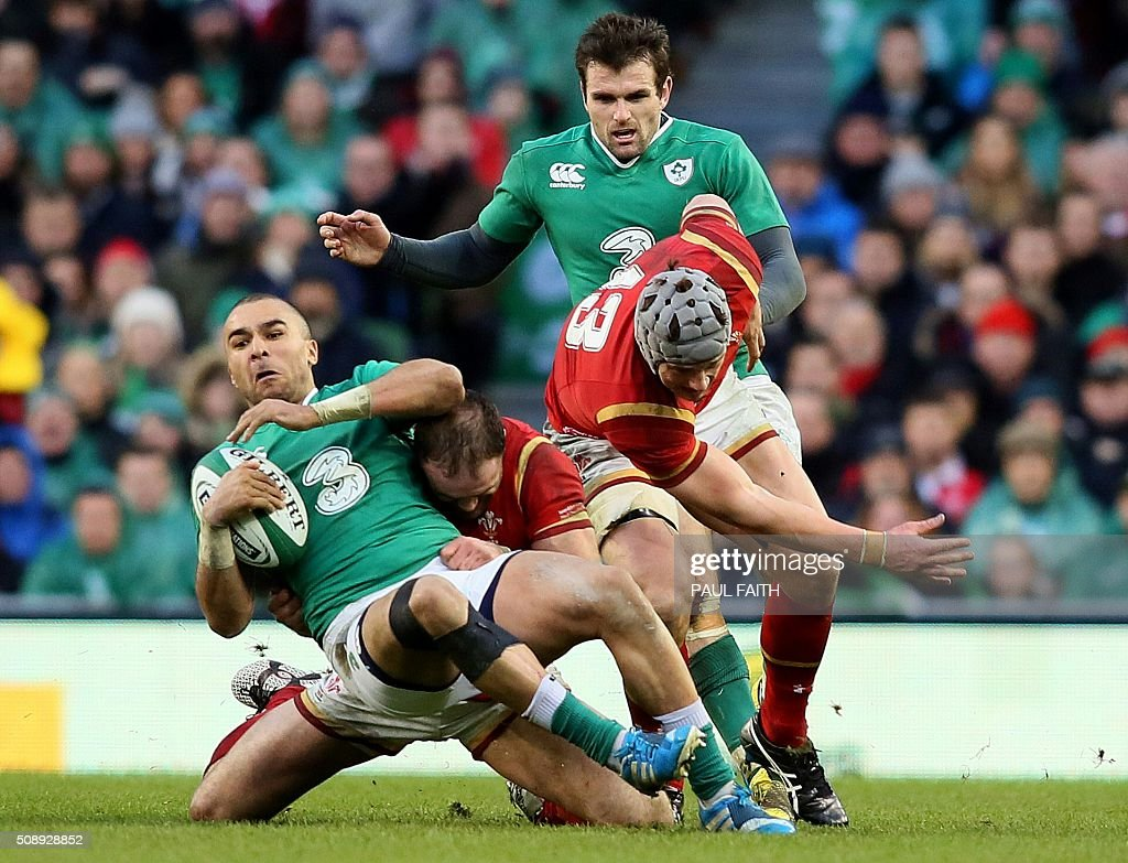 Ireland's full back Simon Zebo (L) is tackled by Wales' centre Jamie Roberts during the Six Nations international rugby union match between Ireland and Wales at the Aviva Stadium in Dublin, Ireland, on February 7, 2016. / AFP / PAUL FAITH