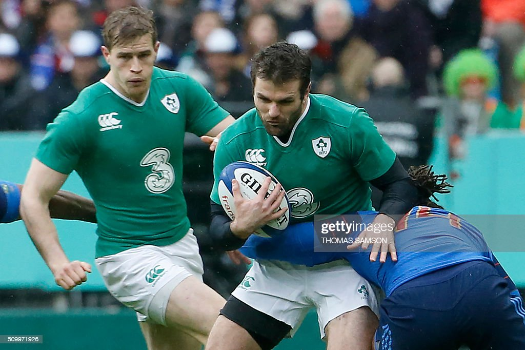 Ireland's fullback Jared Payne is tackled during the Six Nations international rugby union match between France and Ireland at the Stade de France Stadium in Saint-Denis, north of Paris, on February 13, 2016. AFP PHOTO / THOMAS SAMSON / AFP / THOMAS SAMSON