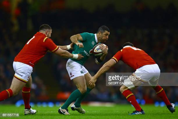 Ireland's fullback Rob Kearney is tackled by Wales' prop Rob Evans and Wales' flanker Sam Warburton during the Six Nations international rugby union...
