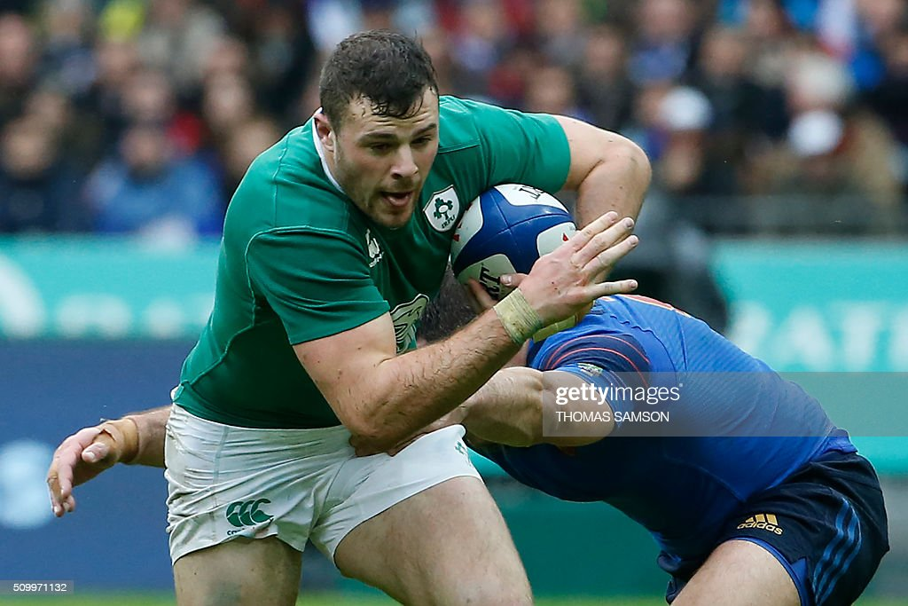 Ireland's fullback Robbie Henshaw is tackled during the Six Nations international rugby union match between France and Ireland at the Stade de France Stadium in Saint-Denis, north of Paris, on February 13, 2016. AFP PHOTO / THOMAS SAMSON / AFP / THOMAS SAMSON