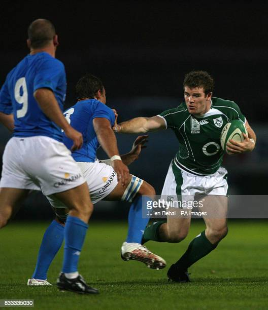 Ireland's Geordan Murphy holding off the tackle of Italy's Sergio Parisse and Alessandro Troncon during the International match at Ravenhill Belfast