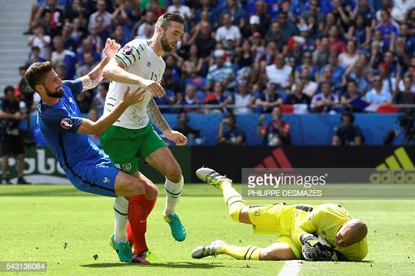 Ireland's goalkeeper Darren Randolph makes a save next to Ireland's defender Shane Duffy and France's forward Olivier Giroud during the Euro 2016...