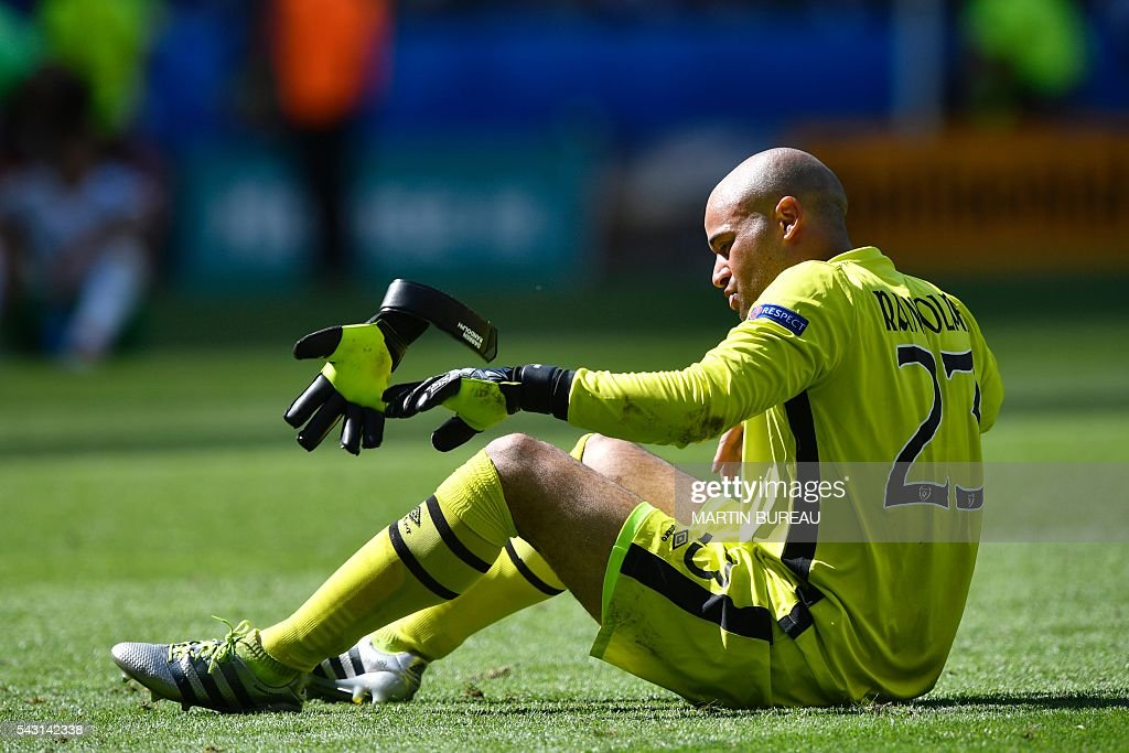 Ireland's goalkeeper Darren Randolph throws away his glove after the Euro 2016 round of 16 football match between France and Republic of Ireland at the Parc Olympique Lyonnais stadium in Décines-Charpieu, near Lyon, on June 26, 2016. / AFP / MARTIN