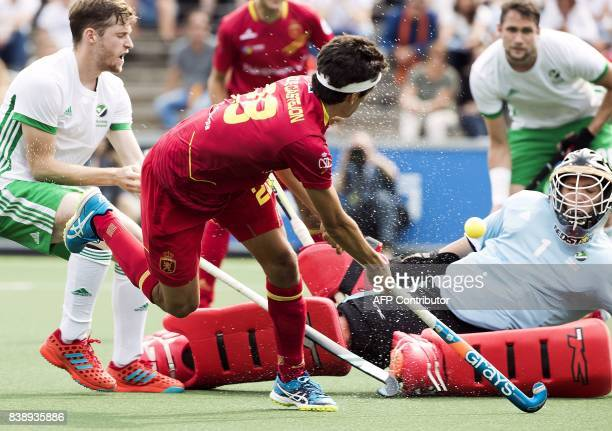 Ireland's goalkeeper David Harte blocks a shot on goal by Spain's Quique Gonzalez during the 2017 Rabo EuroHockey Championships field hockey match...
