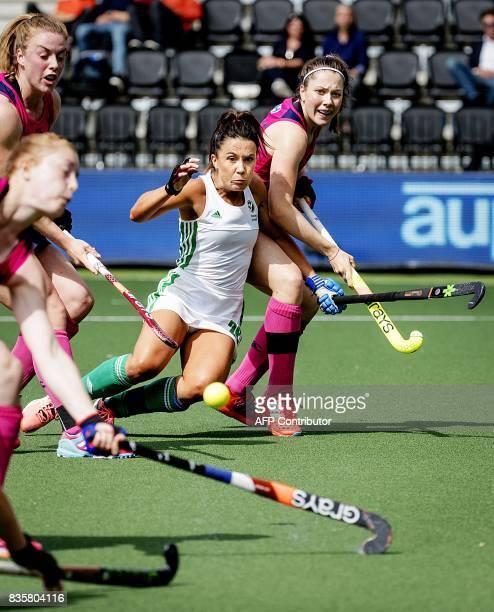 Ireland's Hannah O'Flanagan vies for the ball with Scotland's Amy Costello during the women's Hockey Rabo EuroHockey Championships 2017 match Ireland...