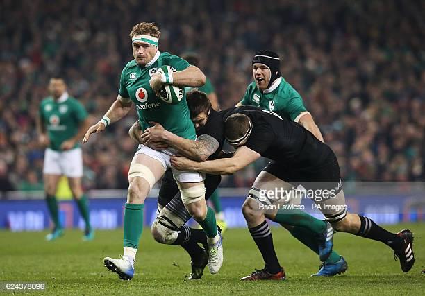 Ireland's Jamie Heaslip against New Zealand's Brodie Retallick and Liam Squire during the Autumn International match at the Aviva Stadium Dublin