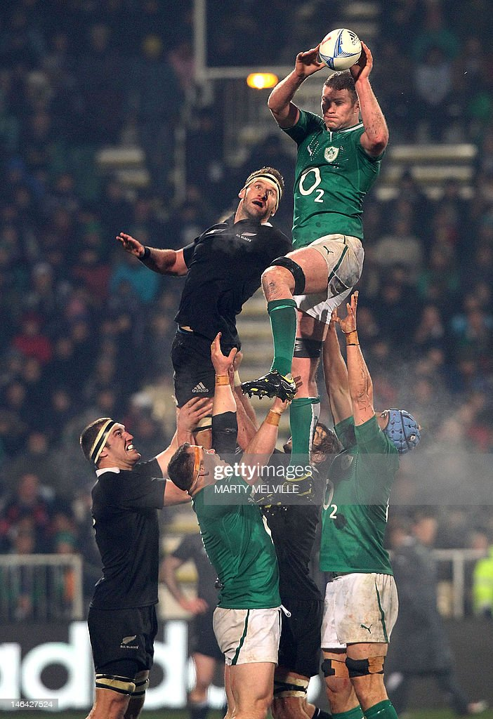 Ireland's Jamie Heaslip takes the line out ball with New Zealand's Kieran Reid in defense during their rugby union match at AMI Stadium in Christchurch on June 16, 2012. The All Blacks beat Ireland 22-19 in the second rugby Test. AFP PHOTO / Marty Melville