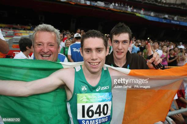 Ireland's Jason Smyth with his coach Stephen Maguire and best friend and fellow gold medalist Michael McKilliop after winning the gold medal in the...