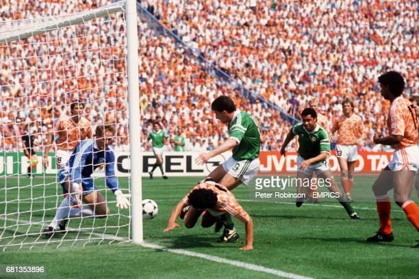 Ireland's John Aldridge is denied by Holland goalkeeper Hans van Breukelen as teammate Paul McGrath races in