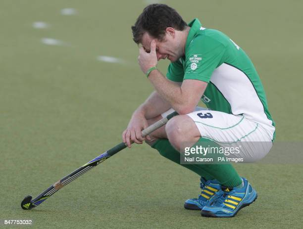 Ireland's John Jackson reacts after they were beaten during their International Hockey Federation Olympic qualifing match at Belfield in Dublin