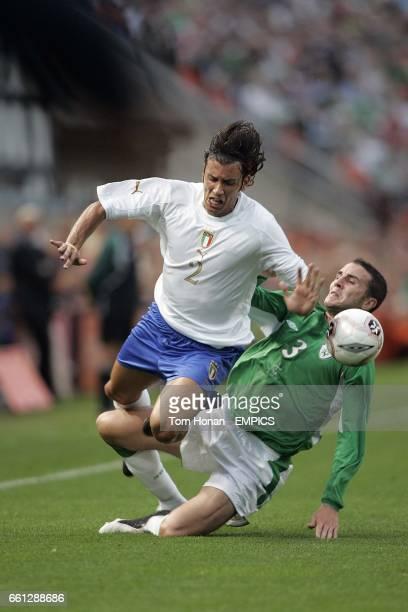 Ireland's John O'Shea and Italy's Cristian Zaccardo battle for the ball