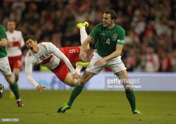 Ireland's John O'Shea and Poland's Robert Lewandowski tussle during the International Friendly at the Aviva Stadium Dublin