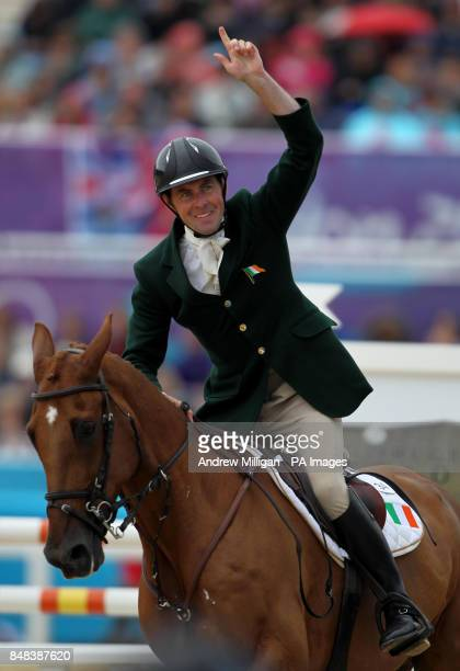Ireland's Joseph Murphy celebrates after completing his round on Electric Cruise during the Individual Eventing Jumping Final on day four of the...