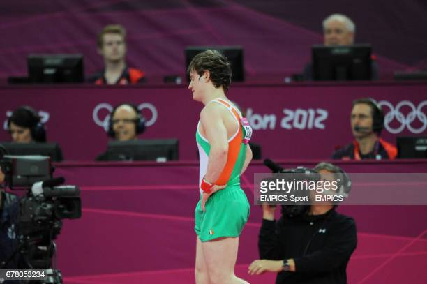 Ireland's Kieran Behan reacts after competing on the Floor during the Artistic Gymnastics team qualification at the North Greenwich Arena London on...