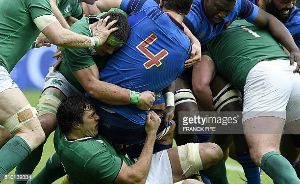 TOPSHOT Ireland's lock Mike McCarthy tackles Frances lock Alexandre Flanquart during the Six Nations international rugby union match between France...