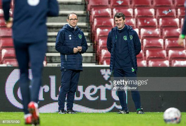 Ireland's manager Martin O'Neill and assistent manager Roy Keane attend a training session at the Telia Parken Stadion in Copenhagen on November 10...