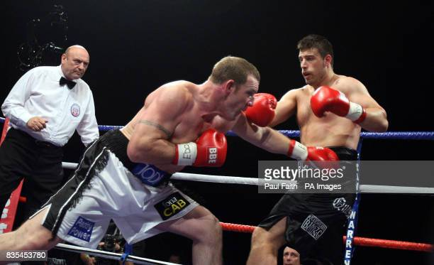 Ireland's Martin Rogan in action against England's Sam Sexton during the Heavyweight Commonwealth Title bout at the Odyssey Arena Belfast Northern...