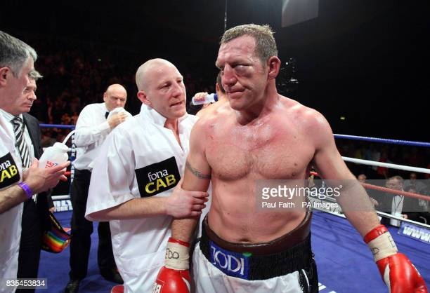 Ireland's Martin Rogan with his cut eye after The referee stops the fight in favour of England's Sam Sexton during the Heavyweight Commonwealth Title...