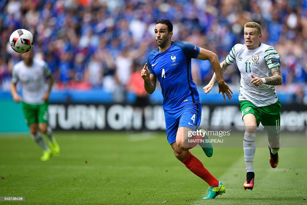 Ireland's midfielder James McClean (R) and France's defender Adil Rami vie for the ball during the Euro 2016 round of 16 football match between France and Republic of Ireland at the Parc Olympique Lyonnais stadium in Décines-Charpieu, near Lyon, on June 26, 2016. / AFP / MARTIN