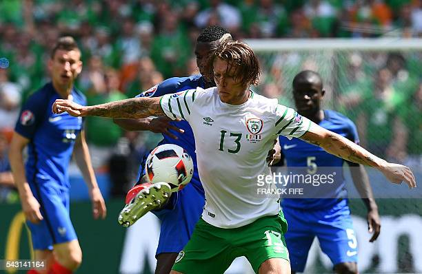 Ireland's midfielder Jeffrey Hendrick and France's midfielder Paul Pogba vie for the ball during the Euro 2016 round of 16 football match between...
