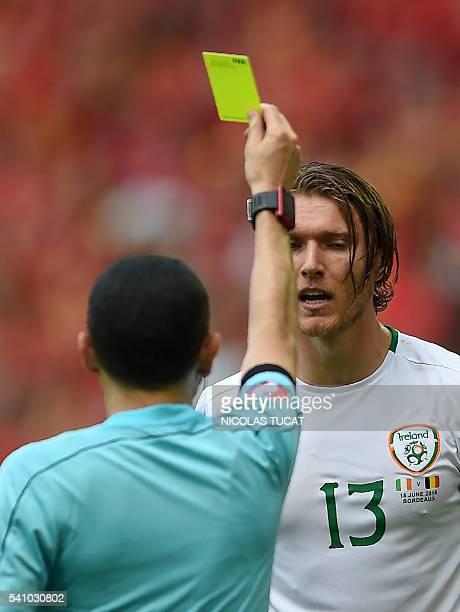 Ireland's midfielder Jeffrey Hendrick receives a yellow card during the Euro 2016 group E football match between Belgium and Ireland at the Matmut...