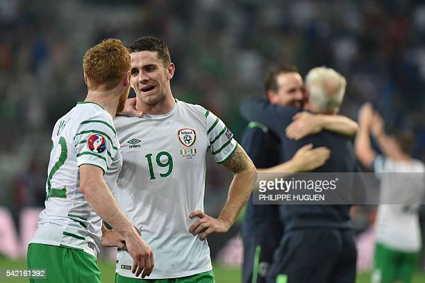 Ireland's midfielder Robert Brady and Ireland's midfielder Stephen Quinn celebrate after the Euro 2016 group E football match between Italy and...