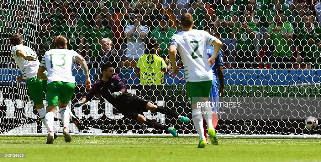 Ireland's midfielder Robert Brady (L) shoots to score against France's goalkeeper Hugo Lloris (C) during the Euro 2016 round of 16 football match between France and Republic of Ireland at the Parc Olympique Lyonnais stadium in Décines-Charpieu, near Lyon, on June 26, 2016. / AFP / FRANCK