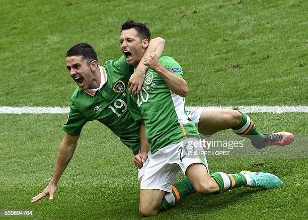 TOPSHOT Ireland's midfielder Wesley Hoolahan celebrates with Ireland's midfielder Robert Brady after scoring during the Euro 2016 group E football...