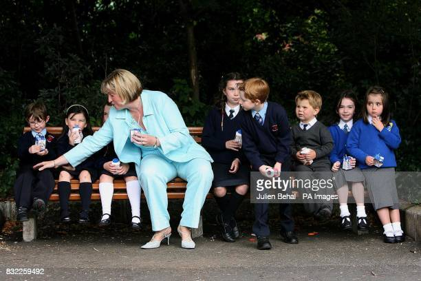 Ireland's Minister for Agriculture and Food Mary Coughlan wipes spilt milk from the school trousers of Cian Lawlor at a photocall to launch the...