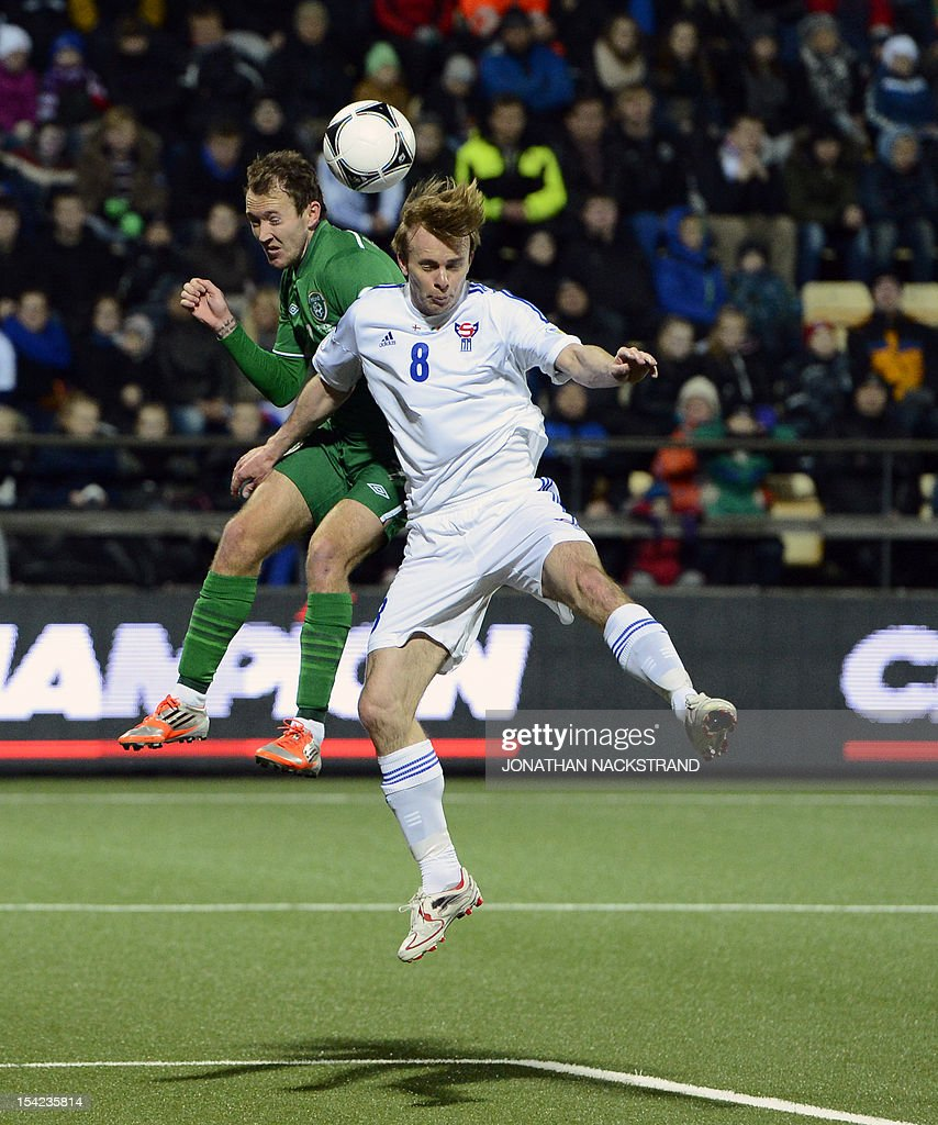 Ireland's national football player Aiden McGeady (L) vies with Faroe Islands's Simun Samuelsen during the FIFA 2014 World Cup group C qualifying football match Faroe Islands vs Ireland at the Torsvollur stadium in Torshavn on October 16, 2012.