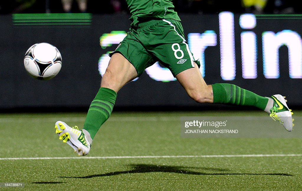 Ireland's national football player Keith Andrews shoots the ball during the FIFA 2014 World Cup group C qualifying football match Faroe Islands vs Republic of Ireland at the Torsvollur stadium in Torshavn on October 16, 2012.